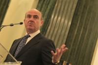 Guindos negocia seguir acelerando la devolución anticipada del rescate bancario
