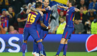El Barça gana a Olympiacos en la tormenta y es más líder