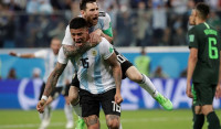 Messi y Rojo resucitan a Argentina
