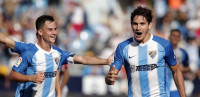 El Málaga tira de remontada y el Dépor toma posiciones