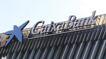 CaixaBank ganó 620 millones en 2014